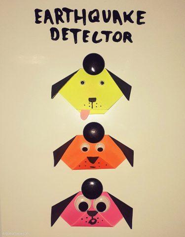Doggo Earthquake Detector: Three origami doggo heads with googly eyes attached.
