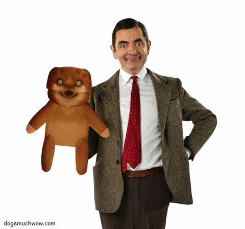 Mr Bean (Rowan Atkinson) holding his Teddy Cheems.