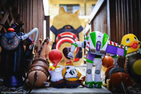 Toys from Toy Story looking at Doge going to school but there is a bondage duck among them. Wow.